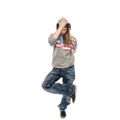 Street dancer girl wearing jeans and hood on head, isolated