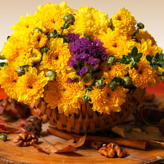 Colorful autumn flowers in rustic decor