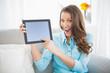 Euphoric woman showing her tablet screen