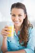 Happy woman holding orange juice