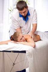 Masseur is massaging female