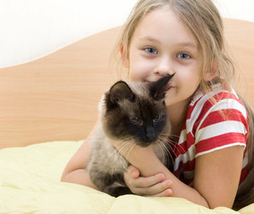 child with a Siamese