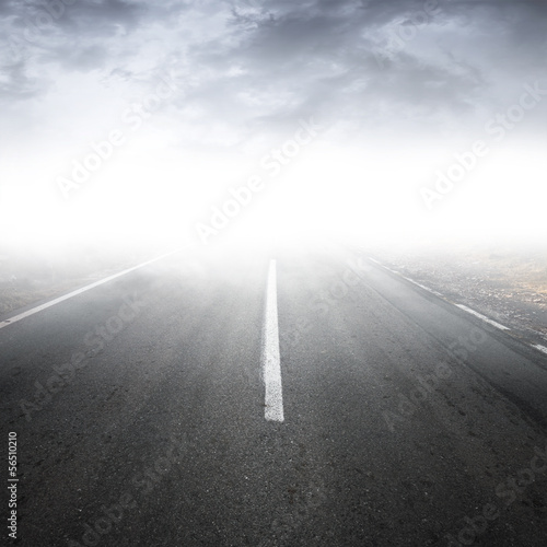 Empty dark rural asphalt highway perspective