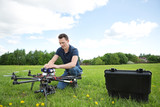 Engineer Fixing UAV Drone in Park