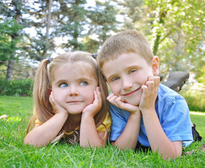 Happy Children Smiling in Green Grass