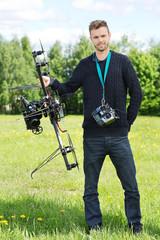 Technician Standing With UAV