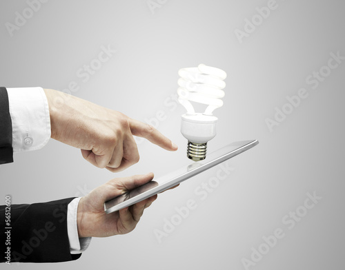 tablet and lightbulb