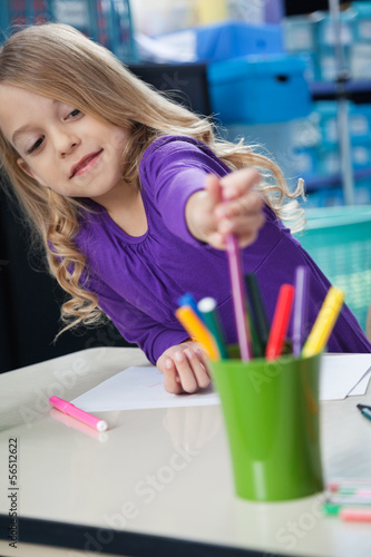 Girl Picking Sketch Pen From Case In Classroom