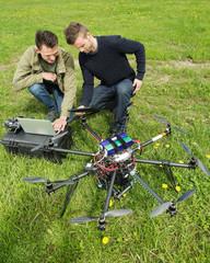 Technicians Discussing UAV