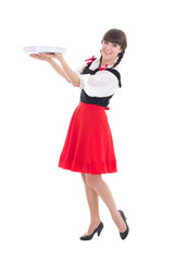 Young and beautiful bavarian girl with tray isolated over white
