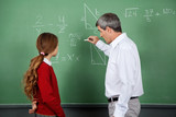 Fototapety Professor Teaching Mathematics To Female Student On Board