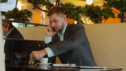 Young, attractive businessman talking on the phone