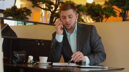 young man doing business over the phone