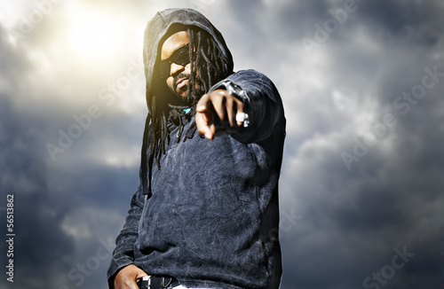 african man in hoodie pointing at camera