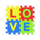 Word LOVE written with alphabet puzzle letters