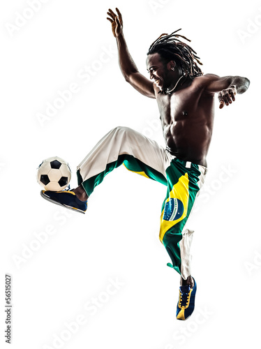 brazilian  black man soccer player juggling football