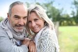 Fototapety Cheerful senior couple enjoying peaceful nature