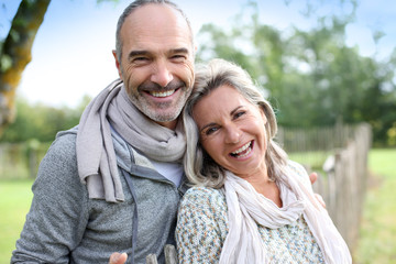 Cheerful senior couple enjoying peaceful nature