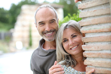 Cheerful senior couple enjoying country home