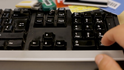 Credit card ecommerce typing PIN on keyboard
