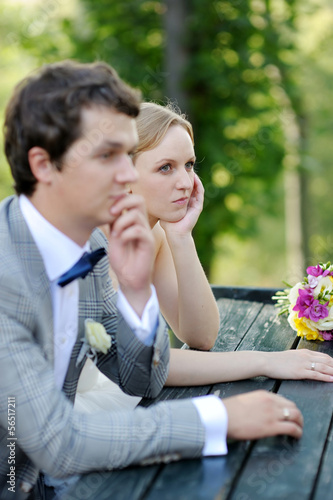 Bride and groom sitting at an outdoor cafe