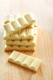 White porous chocolate on wooden background