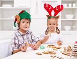 Kids decorating gingerbread christmas cookies