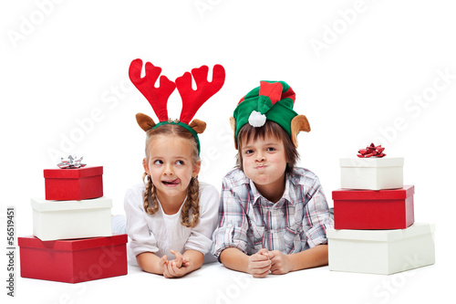 Christmas kids with presents and funny hats - isolated