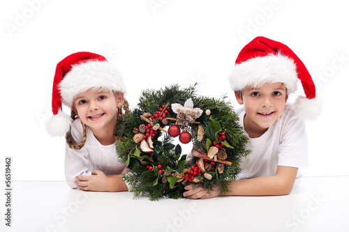 Kids with traditional advent wreath