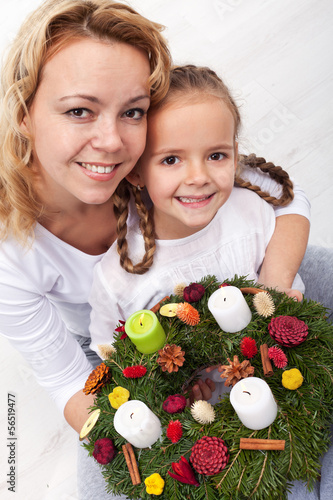 Woman and little girl with advent wreath
