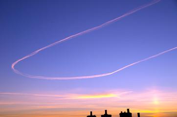 Jet vapour trail against sunset