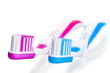 blue and pink toothbrushes lying on a white background