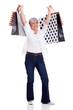 senior woman holding shopping bags
