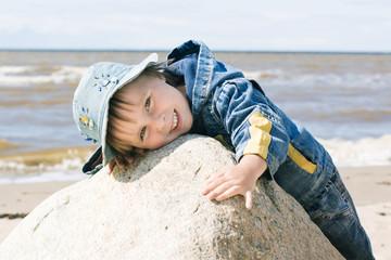 Little kid on the beach.