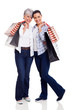 senior mother and daughter holding shopping bags
