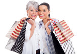 mother and adult daughter carrying shopping bags
