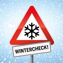 Schild Wintercheck mit Schneeflocke und Schnee