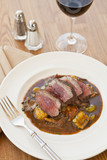 lamb sirloin with herbed gnocchi with a glass of wine