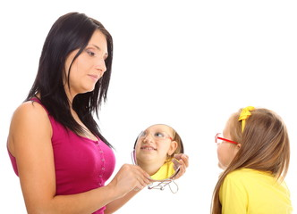 baby girl and mother looking in mirror isolated