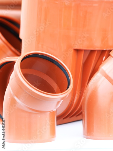 orange pieces- drain pipes pvc on white background