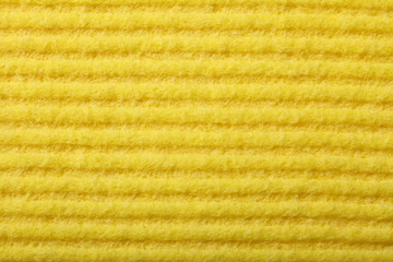 Yellow sponge foam as background texture