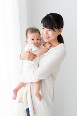 asian baby and mother relaxing