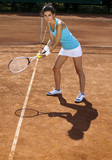Young woman tennis player on the cour