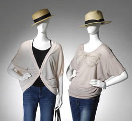 female clothes with hat on a two mannequin