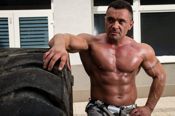 Muscular Man Resting After Tire Flip
