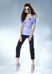 full length shot of fashion model wearing sunglasses