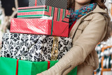 Woman Carrying Stacked Christmas Gifts