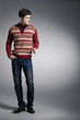 full length young man in sweater dress posing