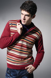 young casual man in sweater dress portrait, isolated