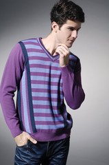 Portrait of a handsome young male in sweater dress